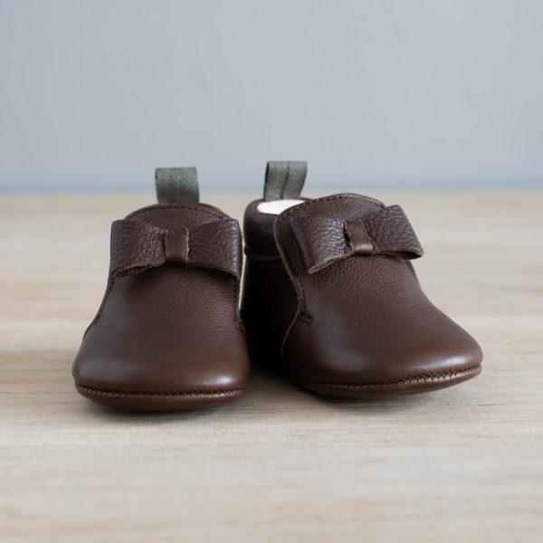 chausson en cuir avec noeud de face